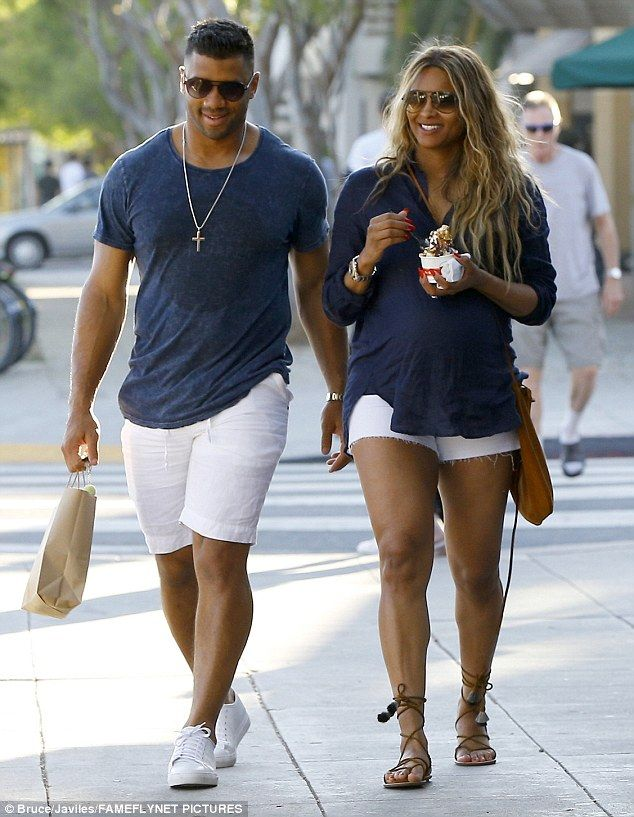 Perfect pair: Pregnant Ciara looked quite carefree on Saturday when she stepped out for some shopping with husband Russell Wilson