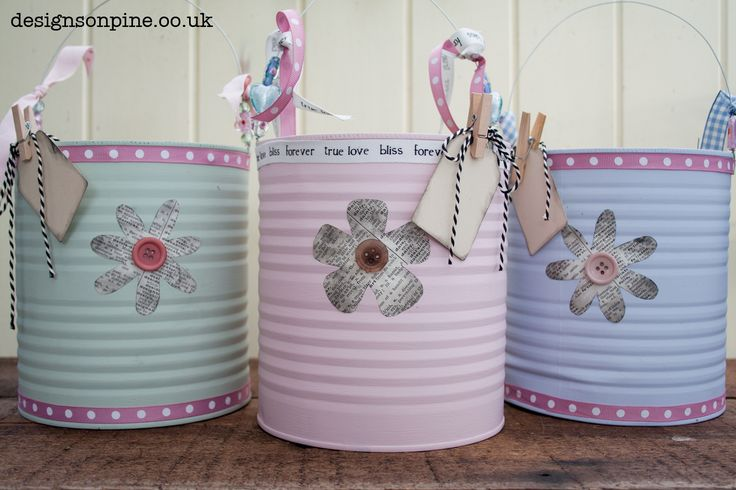 Paint and decorate large catering sized tins to make attractive storage