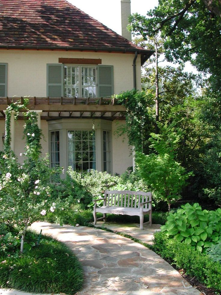 Front yard inspiration-curving line to doorwY with bench along the path, plus arbor over front windows