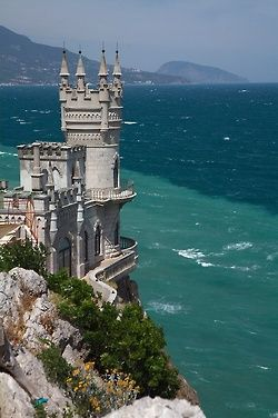 The Swallow's Nest - decorative castle located at Gaspa on the Crimean Peninsula. Built between 1911 and 1912, on top of the 40-metre (130 ft) high Aurora Cliff, in Neo-Gothic design by the Russian architect Leonid Sherwood for the Baltic German oil millionaire, Baron von Steingel. Castle overlooks Cape of Ai-Todor on the Black Sea coast.