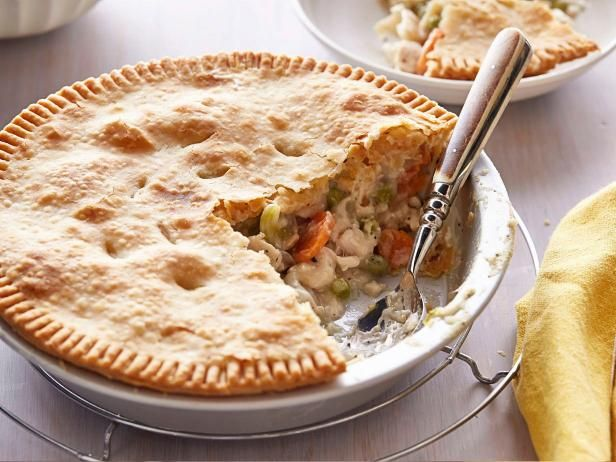Encase buttery meat, seafood or veggie stews in flaky pie dough or top casseroles with drop biscuits to make these creamy, crunchy, comforting classics.
