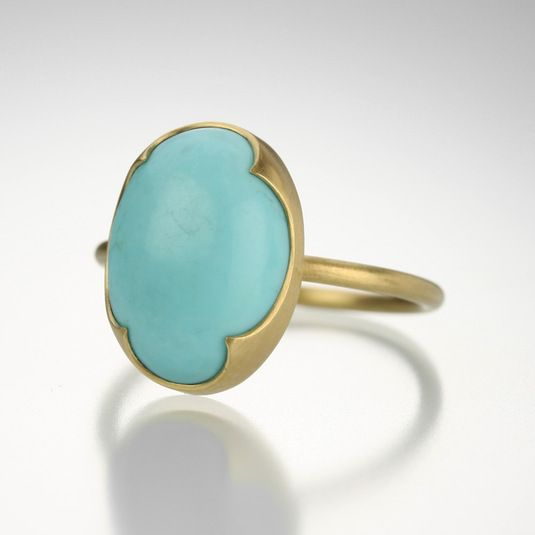 An 18k yellow gold, oval sleeping beauty turquoise ring. Size 7. Stone measures about 11x14.9mm