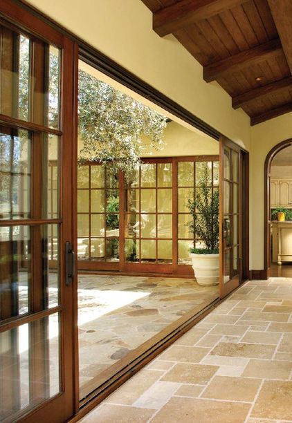 Gorgeous sliding glass doors, but I want the same stone flooring on both sides of the doorway
