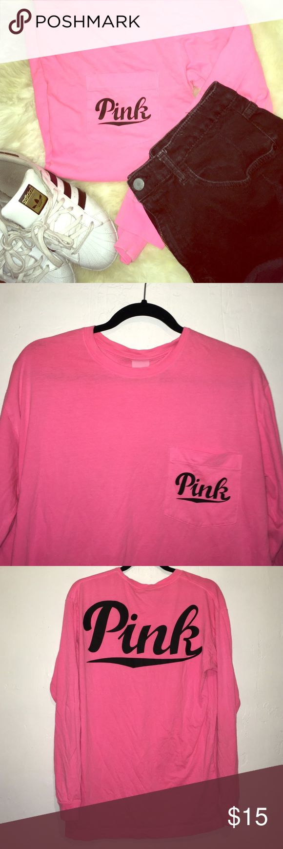 Longsleeve VS pink T-shirt Longsleeve Victoria secret pink, pink T-shirt with a front pocket and pink written across the back. Story time: some reckless lady hit me with her pen, obviously not knowing that all my clothes need to be posh perfect, and now there is a small inc line on the right sleeve (shown in the fourth picture) will update if I figure out how to get out an ink stain.  Black shorts also for sale. PINK Victoria's Secret Tops Tees - Long Sleeve
