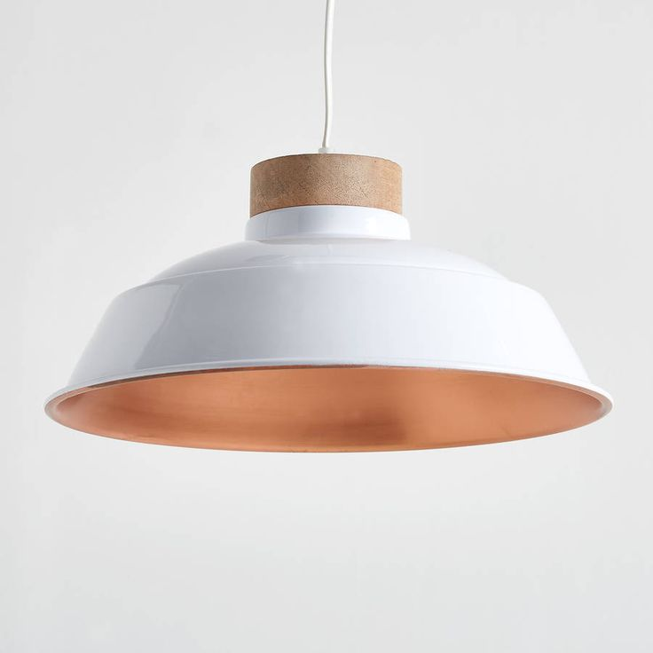 Lovely white and copper pendant light!This stunning wood and metal pendant has been powder coated white, with a copper finish on the inside for a soft warm glow. It comes with approximately 110cm of white flex that can be shortened to any length and matching ceiling rose, as shown. Ideal in kitchens, dining rooms, hallways or living rooms, they look great on their own and also in 2s or 3s. Takes a standard E27 (large screw) bulb and is dimmable.Wood and metal!34cm dia x 17cm high.