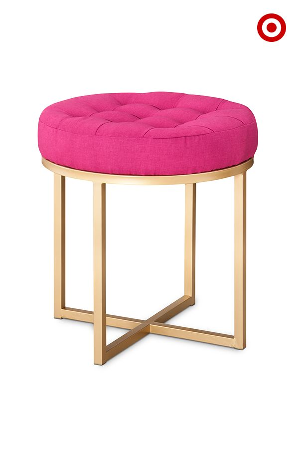 This Threshold button-tufted ottoman is like a hot pink kiss in your living room or bedroom. Use it to spice up your decor.