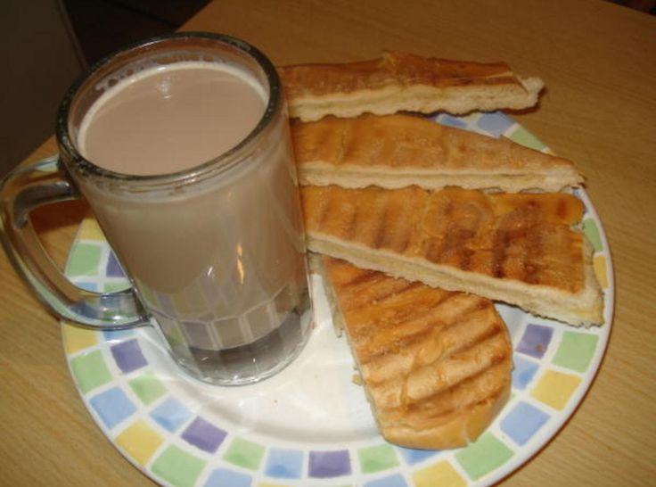 Cuban Cafe Con Leche. Cuban coffee, thicker than expresso, mixed with milk. Buttered Cuban bread with butter then put on a press til toasted. This is the most asked for breakfast, but there are many additions. Including Cuban pastries.