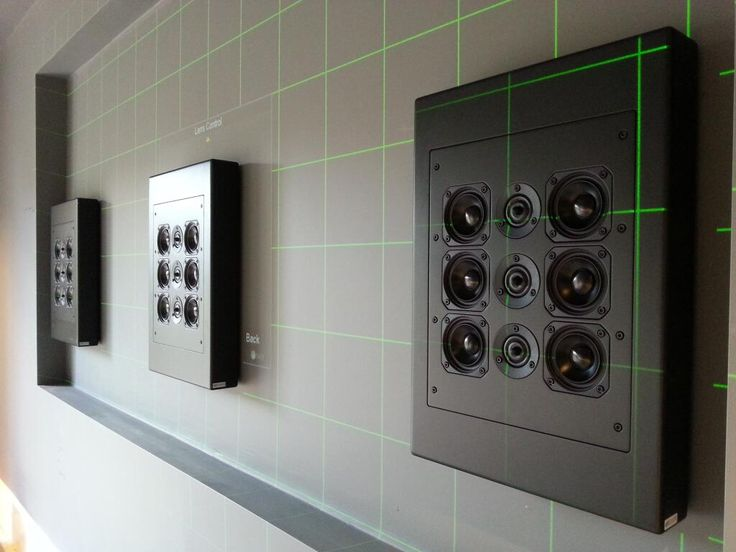 Artcoustic speakers. Hide these behind a projection screen for a discrete install.