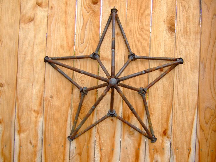 "Welded star made from 5/8"" steel carriage bolts recycled from deconstructed shipping pallets. Approx. 25"" wide."
