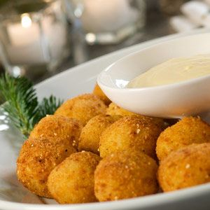 Guests won't be able to resist this crunchy and gooey hors d'ouevre and will be delighted to find melted cheese at the center of this treat.  #arancini  #italianfood #riceballs #