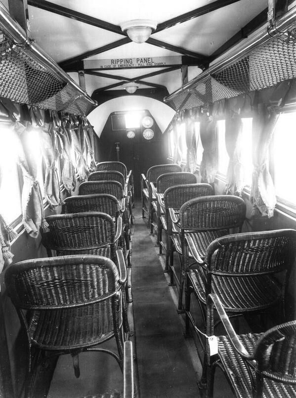 Passenger seating inside an Imperial Airlines biplane. Note the roof panel sign! 1936.