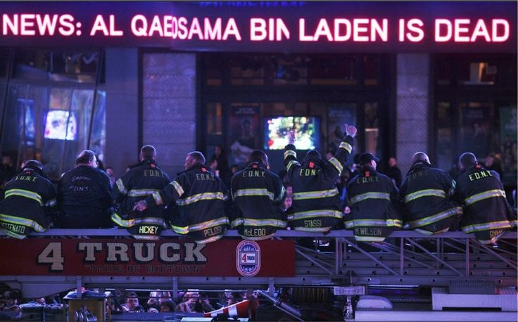 Firefighters of Ladder Company 4 — which lost seven men on 9/11 — perched together on their aerial ladder, watching a news bulletin in Times Square declaring that Osama bin Laden was dead on May 2, 2011