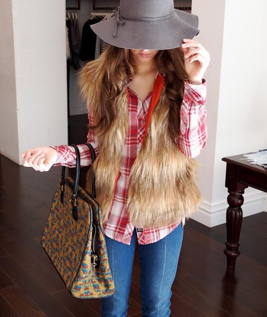 gallery d | shopgalleryd.com vintage travel tote, faux fur vest, plaid blouse, floppy wide brim hat