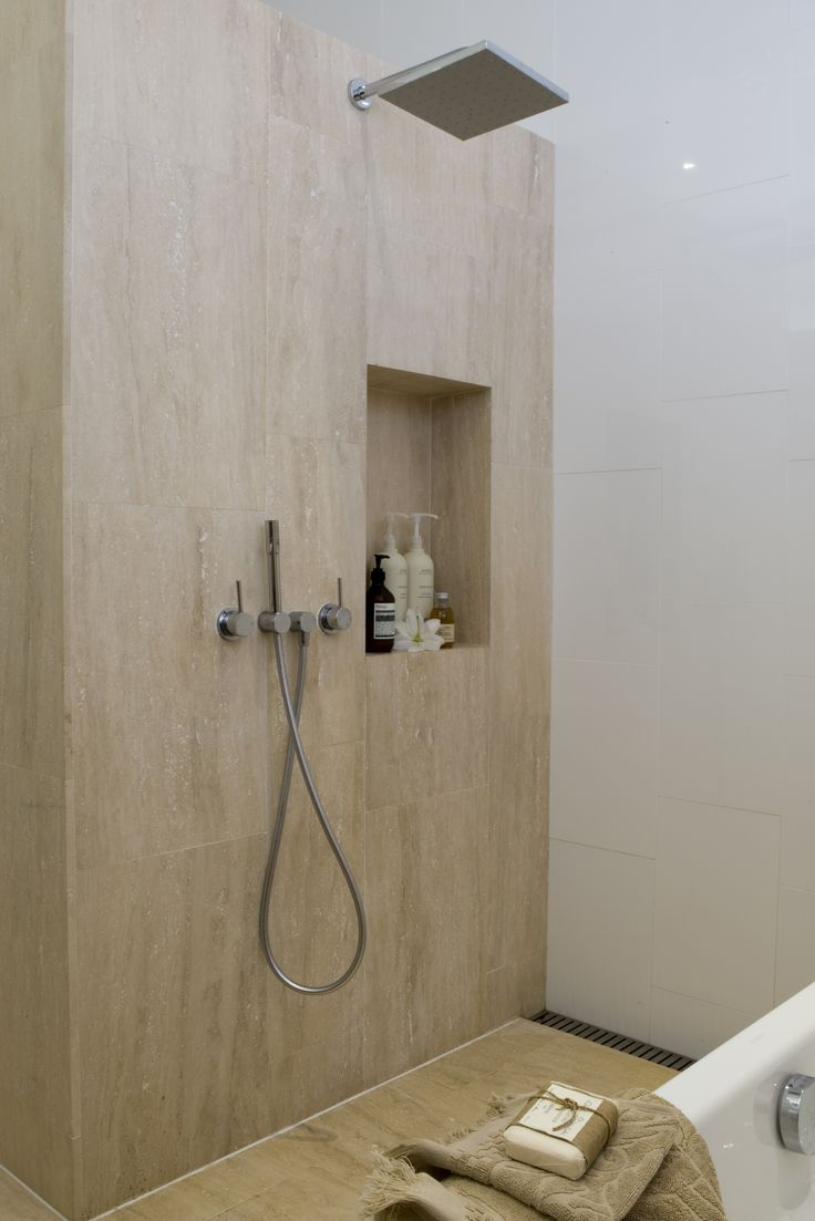Travertine tiled Open Shower space with niche Brooke Aitken Design.