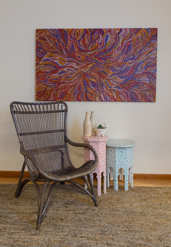 Combining pieces from different cultures reflects the nature of a truly Australian style. Here I've combined tables from Morocco, a rattan chair from the Philippines, a pair of vintage Australian beer bottles and a stunning original Aboriginal art work.