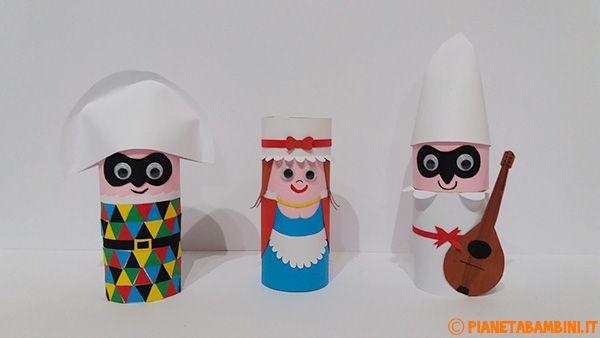 Arlecchino Colombina e Pulcinella con rotolo di carta