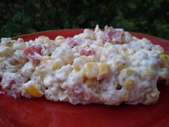 Rotel Corn Dip-also known as cowboy crack! one drained can white corn, 1 block cream cheese, and 1 almost drained can of Rotel. I put it in a glass bowl and microwave it one minute at a time till hot and melted. Serve with Scoop Fritos and keep warm in a small crockpot @ yumpins.comyumpins.com
