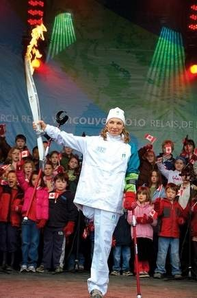 Our very own Sarah Doherty holding up the Olympic Flame in Sechelt, BC.