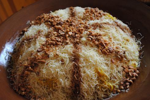 Seffa Medfouna, steamed angel hair pasta chicken, oinions,  almonds... all good