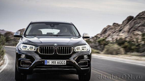 Кроссовер-купе BMW X6 xDrive50i 2015 / БМВ X6 xDrive50i 2015 – вид спереди