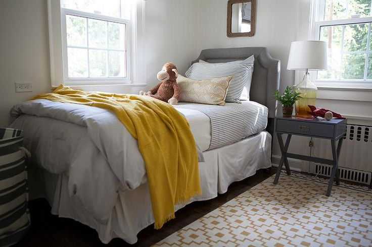 Yellow And Gray Boy S Room Boasts A Rope Mirror Over A