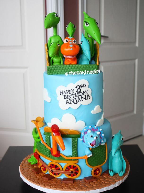 Dinosaur Train Birthday Cake! 3 tier fondant cake with a Dinosaur Train TV show theme design. It has all the characters, Tiny, Shiny, Conductor, Mr. Pteranodon, Buddy.. etc.