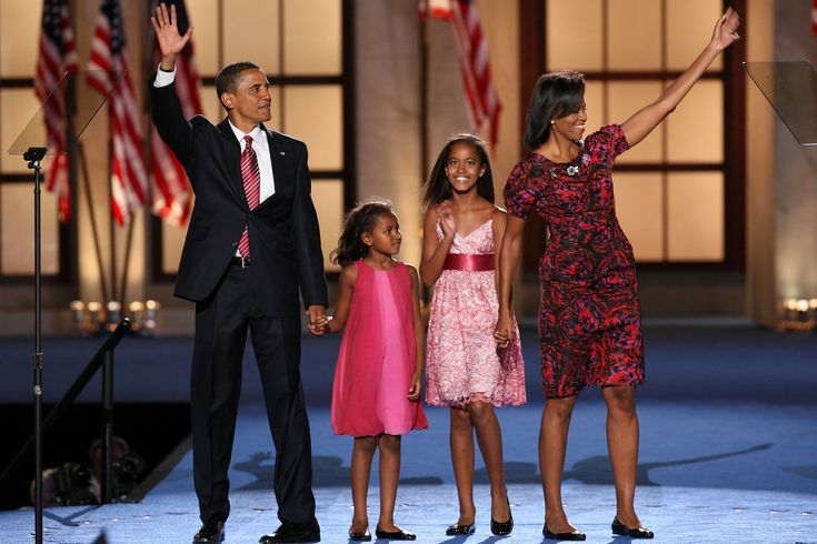 UNITED STATES - AUGUST 28: Senator Barack Obama of Illinois, Democratic presidential candidate, left, his wife Michelle Obama, right, and their daughters, Sasha, left, and Malia Ann, wave to the audience on day four of the Democratic National Convention (DNC) at Invesco Field at Mile High in Denver, Colorado, U.S., on Thursday, Aug. 28, 2008. Obama accepted his party's nomination for presidential candidate during his speech at the stadium tonight. (Photo by Daniel Acker/Bloomberg via Getty…