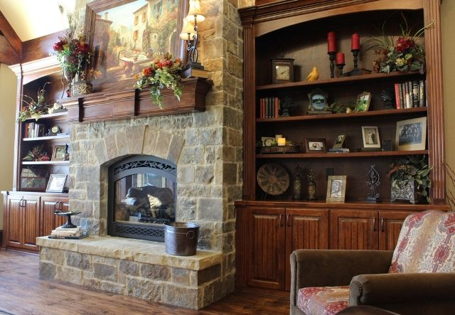 Soaring custom stone fireplace and wood mantle are focus points in this comfortable, lake front home in East Tyler. Designed and built by Trent Williams Construction, Tyler, Texas