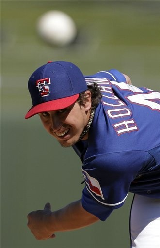 Texas Rangers starting pitcher Derek Holland throws during an exhibition spring training baseball game against the Cleveland Indians Thursday, Feb. 28, 2013, in Surprise, Ariz. (AP Photo/Charlie Riedel)