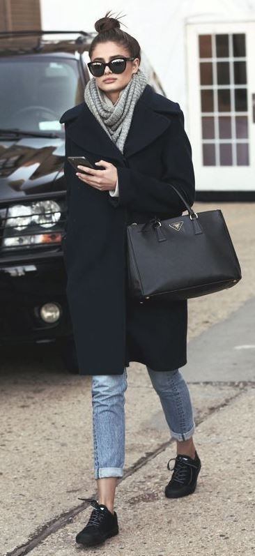 what to wear with a black coat : knit scarf + jeans + sneakers + bag
