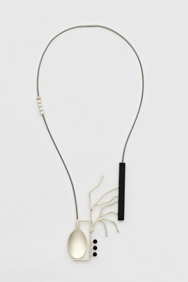 "I admire the simplicity and asymetrical design of this necklace by Katja Prins. While it looks great, I know perfectly well that simplicity is not easy. ""Inter-Act 2012"". Silver, reconstructed onyx, glass, steel"