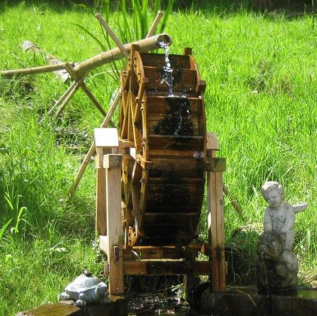 This charming water wheel works with a submersible outdoor pump to bring the water up to the top with the water channeling down to the wheel buckets that drives the wheel. It is a real working water wheel!  The water wheel is designed to use in ponds or streams, the water from the fountain will turn the wheel continuously.