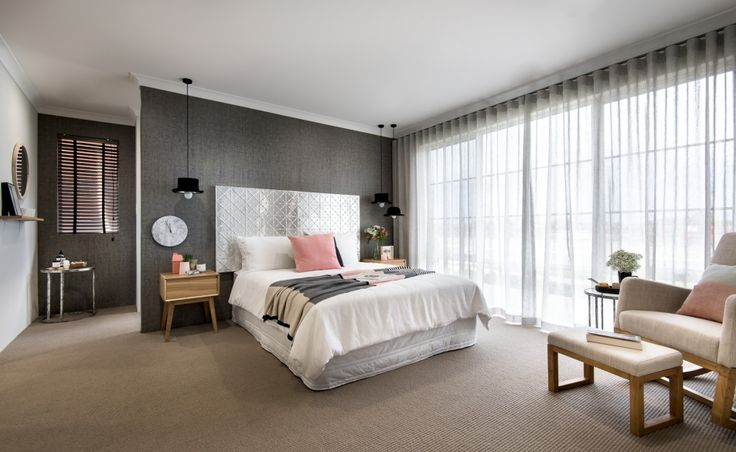 Secluded master suite to front of home with separate 'His' and 'Her' walk in wardrobes