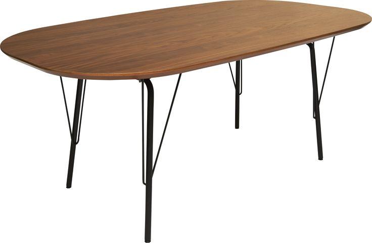 El ovalt spisebord med sortlakkerte ben i metall og en topplate i walnøttfiner. Finnes også med rektangulær topplate i eikefiner. Dimensjoner : L180 x B100 x H75cm. Kr. 8490,-