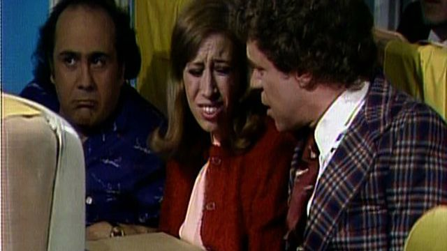 Doug and Wendy Whiner (Robin Duke, Joe Piscopo) are airline passengers who drive their seat-mate (Danny Devito), the stewardess (Mary Gross) and all the other passengers mad with their endless whining. [Season 7, 1982]