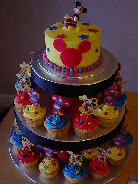 Colorful Mickey cupcakes....We an out his smash cake on top of the cupcake tower!