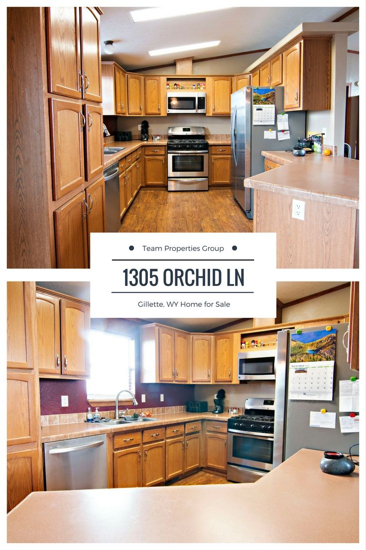 This horseshoe style kitchen offers ample cabinetry and extra seating at the breakfast bar. Don't miss the turnkey 1305 Orchid Ln in Gillette, WY.