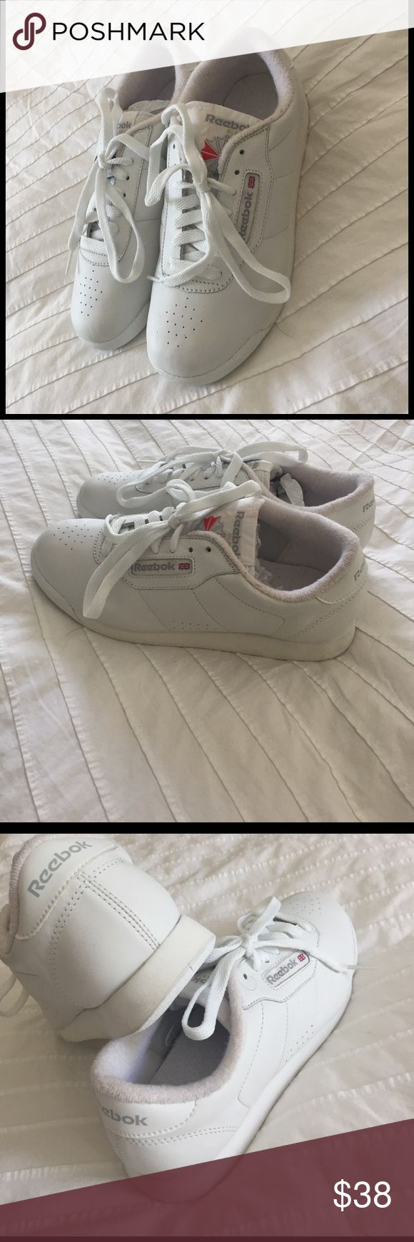 Reebok women's vintage classic sneakers Just got these on Poshmark, would love to keep them but they are a half size bigger than noted, they are 8.5 size in my opinion. In exellent condition, I don't think they have been worn once. Reebok Shoes Athletic Shoes