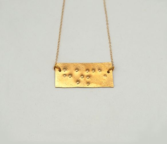 Braille Necklace... to ponder a braille tattoo kinda an oxymoron I know