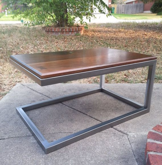 Cantilevered steel base coffee table with von ConcreteConfections