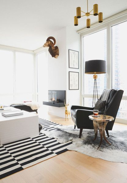 "Noa Santos Manhattan Apartment: ""I had a very clear idea of how I wanted the space to function because we entertain a lot,"" says Santos. A leather armchair by Bryght provides a comfortable perch by the window."