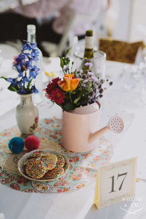Table decorations - mismatched! Country garden but with a modern pop twist!