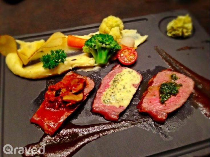 Thinly Sliced Black Angus Steaks With Three kinds of specialty sauces at Auroz