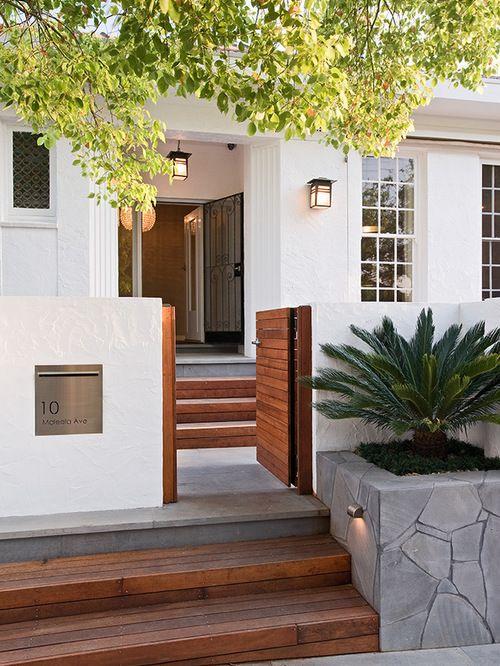 Wood steps against white exterior