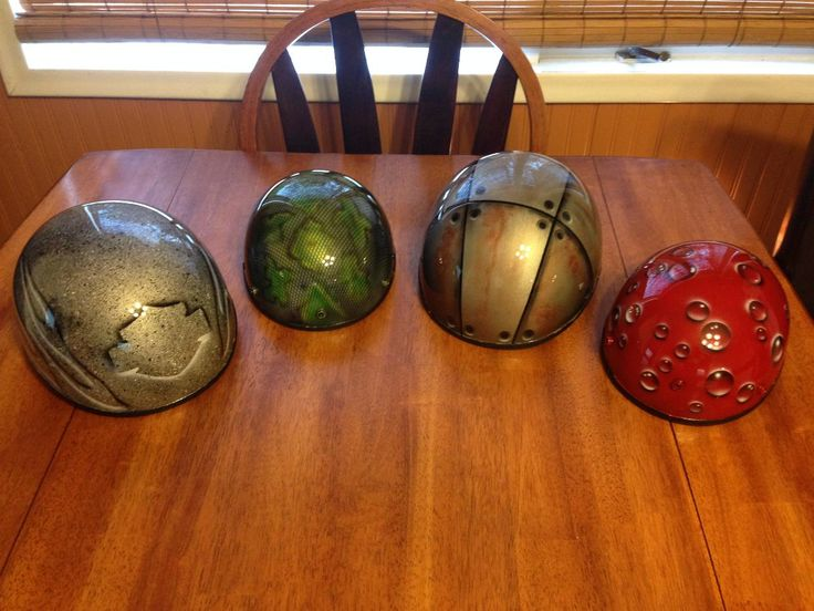 Cleaned out the garden shed, and got creative with our old helmets!