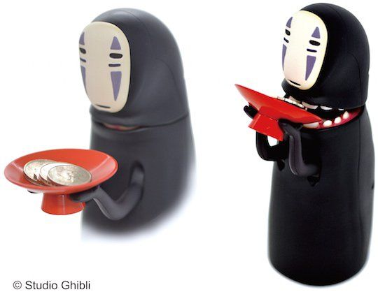 Spirited Away Kaonashi No-Face Piggy Bank - One of the most memorable characters in the classic Studio Ghibli anime Spirited Away is Kaonashi, or No-Face. The black-suited lonely spirit with an expressionless visage is not as scary as he first seems. In fact, Kaonashi will even store your spare coins for you! The Kaonashi No-Face Piggy Bank i ...