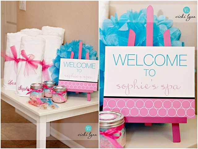 Robes bundles with name tag and tulle on table next to welcome sign.....cute