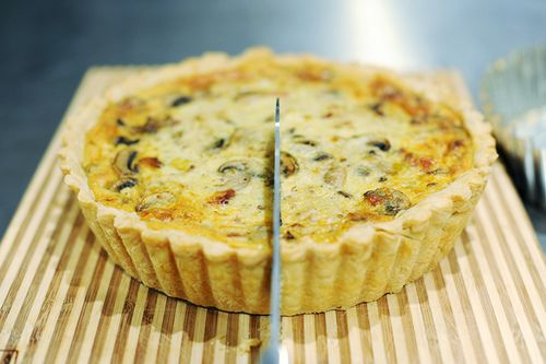 Pioneer woman's quiche with bacon, swiss, artichocke hearts and mushrooms.  I think this is the ONE!