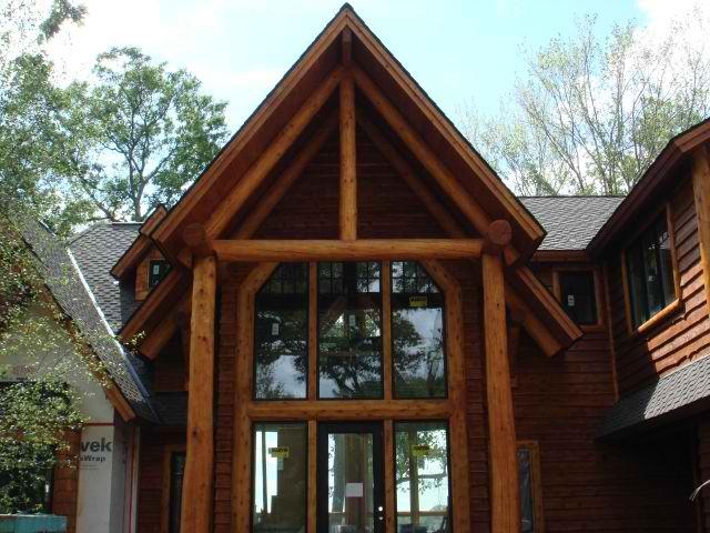 The beautiful windows make this home very inviting log for E log siding