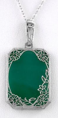 1920s NICE ART DECO/VINTAGE GREEN GLASS FILIGREE STERLING SILVER PENDANT w CHAIN listed on eBay by art_deco_lovers. Via Diamonds in the Library.